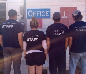 Image of staff with their staff shirts.