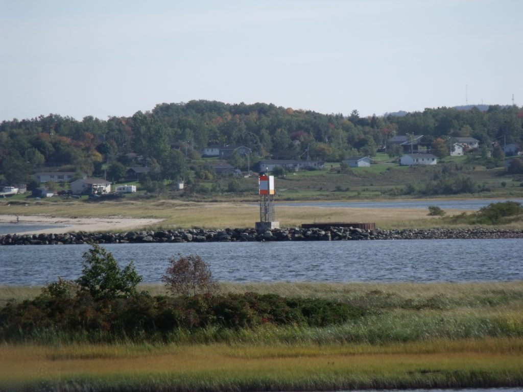 Image of the light beacon on the peninsula across from Harbour Light Campground.