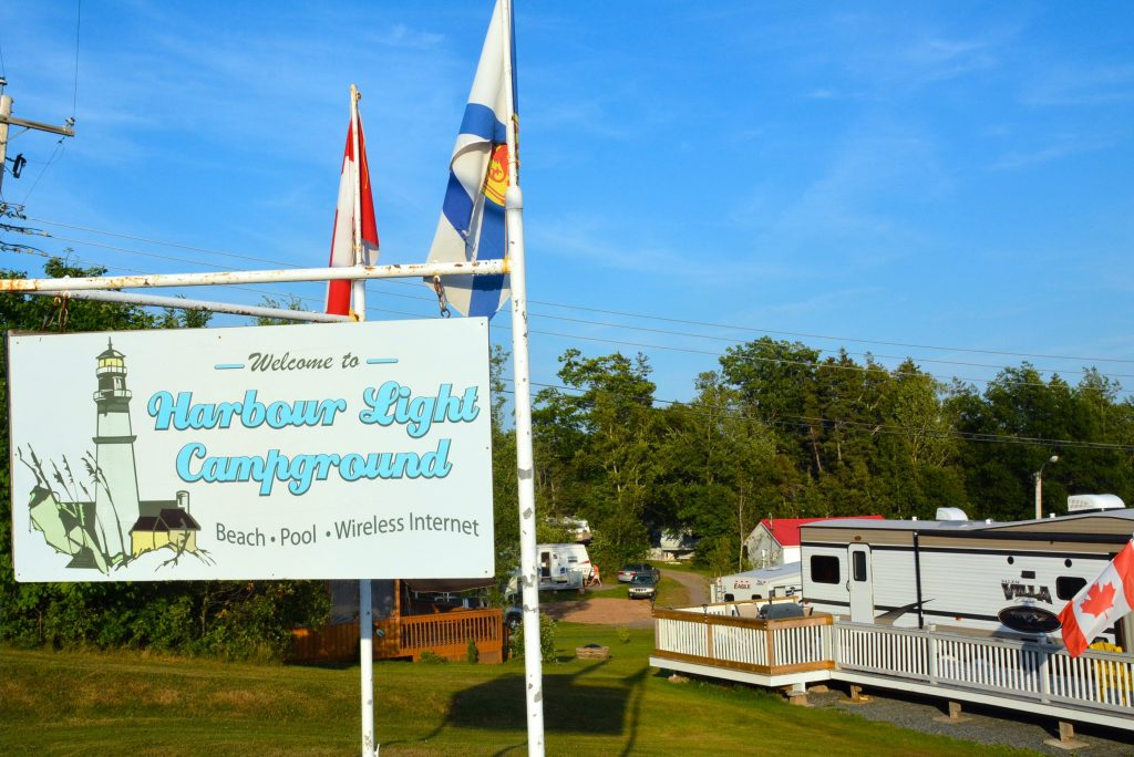 Image of Harbour Light Campground welcome sign.